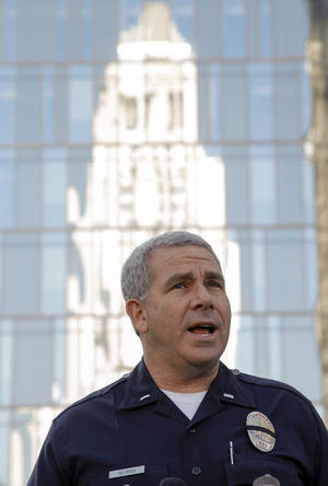 photo - Los Angeles police Lt. Andrew Neiman, left, takes questions from the media at news conference about conviction of former police officer Christopher Jordan Dorner, outside the LAPD headquarters downtown Los Angeles Monday, Feb 11,  2013. Dorner was charged Monday with murdering a police officer and attempting to murder three others in Riverside County. (AP Photo/Nick Ut)