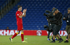 Photo - Wales' Gareth Bale applauds the fans as he walks off after the final whistle of their World Cup Group A qualifying soccer match against Serbia at Cardiff City Stadium in Cardiff, Wales, Tuesday, Sept. 10, 2013. (AP Photo/Matt Dunham)