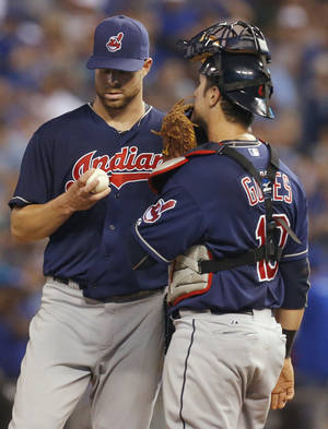 Photo - Cleveland Indians starting pitcher Corey Kluber, left, talks with catcher Yan Gomes during the third inning of a baseball game against the Kansas City Royals at Kauffman Stadium in Kansas City, Mo., Tuesday, Sept. 17, 2013. (AP Photo/Orlin Wagner)