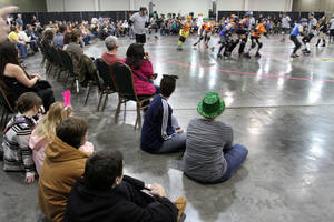 NEW YEAR&#039;S EVE CELEBRATION / ROLLER DERBY: The OKC Roller Girls skate during Opening Night 2012 festivities at the Cox Convention Center in downtown Oklahoma City, Saturday, December 31 2011. PHOTO BY HUGH SCOTT, FOR THE OKLAHOMAN  ORG XMIT: KOD