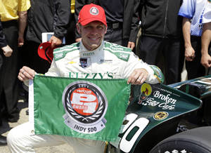 Photo - Ed Carpenter displays the P1 award flag after winning the pole during qualifications for the Indianapolis 500 IndyCar auto race at the Indianapolis Motor Speedway in Indianapolis, Sunday, May 18, 2014. (AP Photo/Michael Conroy)