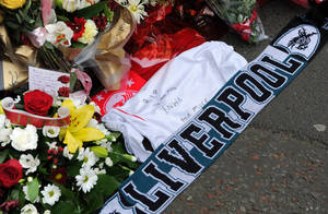 Photo - Tributes are laid at the memorial of the Hillsborough disaster outside Anfield before the English Premier League soccer match between Liverpool and Manchester City at Anfield in Liverpool, England, Sunday April. 13, 2014. (AP Photo/Clint Hughes)