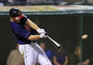 photo -   Cleveland Indians' Shelley Duncan doubles off Chicago White Sox relief pitcher Matt Thornton to drive in the go-ahead run in the eighth inning of the second game of a baseball doubleheader Monday, May 7, 2012, in Cleveland. The Indians held on to win 3-2. (AP Photo/Mark Duncan)