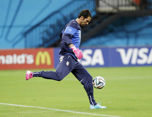 Photo - Italy's goalkeeper Gianluigi Buffon practices his goal kicks during a training session at Arena da Amazonia in Manaus, Brazil, Friday, June 13, 2014.  Italy plays in group D of the 2014 soccer World Cup. (AP Photo/Marcio Jose Sanchez)