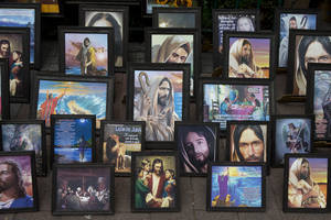 Photo - Pictures of Jesus are displayed for sale in the main plaza of Xochimilco, on the southern edge of Mexico City, Wednesday, May 7, 2014. In Xochimilco, busy markets stand side by side with colonial churches, and children ride to school in boats pushed by poles, along a network of canals and floating gardens that date to pre-hispanic times. The popular tourist destination was declared a UNESCO world heritage site in 1987. (AP Photo/Rebecca Blackwell)