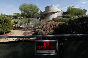 "Photo -   A ""No Trespassing"" sign hangs on a fence outside a 1952 Frank Lloyd Wright-designed home in the Arcadia neighborhood of Phoenix, Wednesday, Oct. 3, 2012. The city of Phoenix and a developer who was poised to demolish the home have reached an agreement that will put any work on hold while a search continues for a buyer, a city official confirmed Wednesday. (AP Photo/Ross D. Franklin)"