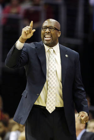 Photo - In this April 5, 2014 photo, Cleveland Cavaliers head coach Mike Brown yells at his team during an NBA basketball game against the Charlotte Bobcats in Cleveland. On Monday, May 12, 2014, the Cavaliers announced Brown has been released as head coach. (AP Photo)