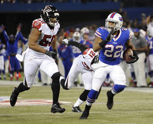 Photo - Buffalo Bills running back Fred Jackson (22) scores a touchdown past Atlanta Falcons defensive end Osi Umenyiora (50) during the second half of an NFL football game on Sunday, Dec. 1, 2013, in Toronto. (AP Photo/Gary Wiepert)