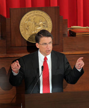 Photo - North Carolina Gov. Pat McCrory delivers the State of the State address at the Legislative Building in Raleigh, N.C., Monday, Feb. 18, 2013.  (AP Photo/Ted Richardson)