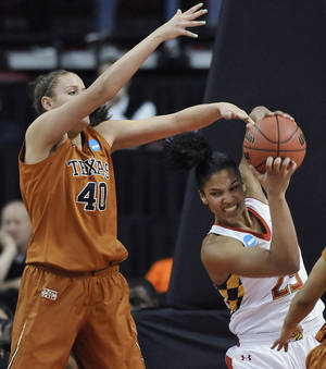 Photo - Maryland's Alyssa Thomas, right, fights for a rebound against Texas center Kelsey Lang during the first half of a second-round game of the NCAA women's college basketball tournament, Tuesday, March 25, 2014, in College Park, Md.(AP Photo/Gail Burton)