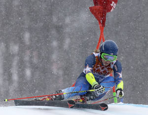 Photo - United States' Mikaela Shiffrin passes a gate in the second run of the women's giant slalom at the Sochi 2014 Winter Olympics, Tuesday, Feb. 18, 2014, in Krasnaya Polyana, Russia. (AP Photo/Luca Bruno)