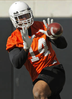 Photo - COLLEGE FOOTBALL: Justin Horton (14) catches the ball during OSU spring football practice at Boone Pickens Stadium on the campus of Oklahoma State University in Stillwater, Okla., Monday, March 12, 2012. Photo by Nate Billings, The Oklahoman