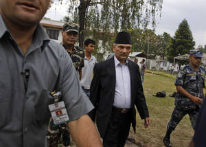 Photo -   Nepal's Prime Minister Baburam Bhattarai, second right, walks escorted by security officers after meeting with leaders of major political parties in Katmandu, Nepal, Thursday, May, 3, 2012. In a last-ditch effort to finish years of work on Nepal's new constitution, Prime Minister Bhattarai will dissolve his Cabinet and form a new coalition government that includes members of the main opposition parties, an aide said Thursday. (AP Photo/Binod Joshi)