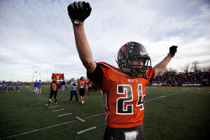 Photo - Tonkawa's Kyle Smith (24) celebrates a win over Hennessy during the Class A State semifinal football game, Saturday, Dec. 5, 2009, at Putnam City High School in Oklahoma City. Photo by Sarah Phipps, The Oklahoman