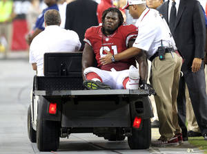 Photo - Arizona Cardinals first round draft pick Jonathan Cooper (61) is carted off the field after being injured during the second half of a preseason NFL football game  against the San Diego Chargers, Saturday, Aug. 24, 2013, in Glendale, Ariz. (AP Photo/Rick Scuteri)