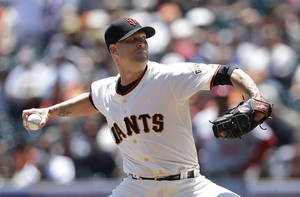 Photo - San Francisco Giants pitcher Tim Hudson throws against the Washington Nationals during the first inning of a baseball game in San Francisco, Thursday, June 12, 2014. (AP Photo/Jeff Chiu)