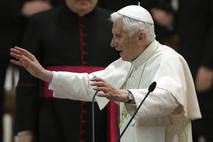photo - Pope Benedict XVI delivers his blessing after an audience with the Roman clergy in the Paul VI Hall at the Vatican, Thursday Feb. 14, 2013. Benedict XVI is continuing his farewell tour with an off-the-cuff meeting with Roman priests, an annual encounter that has taken on poignant new meaning with his impending resignation.The Vatican has said Benedict would reflect Thursday on his personal experiences as a young theological expert attending the Second Vatican Council, the 1962-65 meetings that brought the Catholic Church into the modern world. (AP Photo/Alessandra Tarantino)