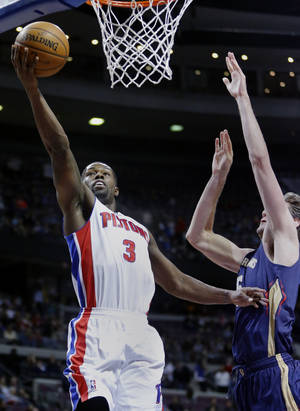 Photo - Detroit Pistons guard Rodney Stuckey (3) goes in for a layup against New Orleans Pelicans center Jeff Withey during the first half of an NBA basketball game Friday, Jan. 24, 2014, in Auburn Hills, Mich. (AP Photo/Duane Burleson)