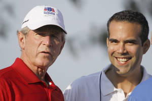 Photo -   FILE - In this Monday, Sept. 24, 2012, file photo George P. Bush, right, stands with his uncle former President George W. Bush, left, during the Bush Center Warrior Open in Irving, Texas. George P. Bush, son of one-time Florida Gov. Jeb Bush, has made a campaign filing in Texas that is required of candidates planning to run for state office, an official said Thursday, Nov 8, 2012. (AP Photo/LM Otero, File)
