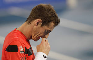Photo - Andy Murray of Britain reacts during a match against Jo-Wilfried Tsonga of France during the first day of the Mubadala World Tennis Championship in Abu Dhabi, United Arab Emirates, Thursday Dec. 26, 2013. (AP Photo/Kamran Jebreili)