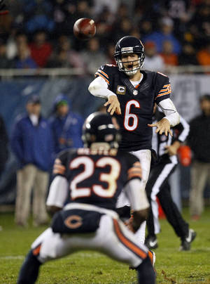 photo -   Chicago Bears quarterback Jay Cutler (6) throws an illegal forward pass to wide receiver Devin Hester (23) in the first half an NFL football game in Chicago, Sunday, Nov. 11, 2012. The Texans won 13-6. (AP Photo/Charles Rex Arbogast)