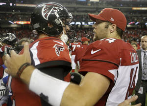 Photo -   Atlanta Falcons quarterback Matt Ryan (2) speaks with Arizona Cardinals quarterback Ryan Lindley (14) after the second half of an NFL football game Sunday, Nov. 18, 2012, in Atlanta. The Falcons won 23-19. (AP Photo/David Goldman)
