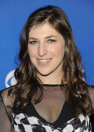 "Photo -   FILE - This May 16, 2012 file photo shows Actress Mayim Bialik from the show ""The Big Bang Theory"" attending the CBS network upfront presentation at The Tent at Lincoln Center, in New York. Bialik has been hospitalized after sustaining injuries in a car accident in Hollywood area of Los Angeles. Los Angeles Police spokesman Richard French says the 36-year-old actress sustained severe lacerations to her left hand and thumb shortly before noon Wednesday Aug. 15, 2012, when another car made a left turn and crashed into Bialik's vehicle, activating the air bags. (AP Photo/Evan Agostini, File)"