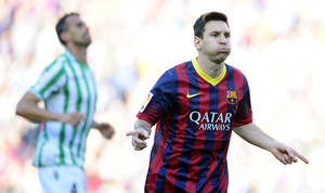 Photo - FC Barcelona's Lionel Messi gestures after scoring during a Spanish La Liga soccer match against Betis at the Camp Nou stadium in Barcelona, Spain, Saturday, April 5, 2014. (AP Photo/Manu Fernandez)