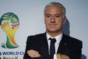 Photo - Didier Deschamps, head coach of the national football team of France, looks on following the draw for the 2014 FIFA World Cup European zone play-off  soccer matches on Monday, Oct. 21, 2013, at the FIFA headquarters in Zurich, Switzerland. (AP Photo/Keystone,Steffen Schmidt)