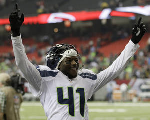 Photo - Seattle Seahawks cornerback Byron Maxwell (41) celebrates a Seattle Seahawks victory over the Atlanta Falcons 33-10 after the second half of an NFL football game, Sunday, Nov. 10, 2013, in Atlanta. (AP Photo/John Bazemore)