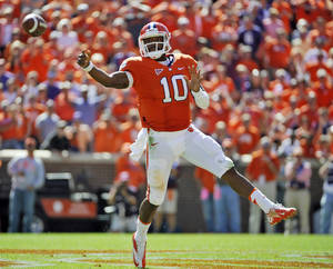 photo -   Clemson quarterback Tajh Boyd throws a pass against Virginia Tech during the second half of an NCAA college football game on Saturday, Oct. 20, 2012, in Clemson, S.C. (AP Photo/Rainier Ehrhardt)