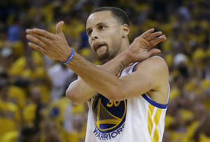 Photo - Golden State Warriors shooting guard Stephen Curry gestures against the Los Angeles Clippers during the first quarter of Game 6 of an opening-round NBA basketball playoff series in Oakland, Calif., Thursday, May 1, 2014. (AP Photo/Marcio Jose Sanchez)