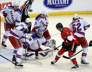 Photo - New York Rangers goaltender Henrik Lundqvist (30) makes a save as he is surrounded by teammates Ryan McDonagh (17) Benoit Pouloit (67) Dan Giradi (5) and Carl Hagelin (62) as Ottawa Senators' Kyle Turris (7) looks on during third period NHL hockey action in Ottawa, Ontario, Tuesday March 18, 2014. New York defeated Ottawa 8-4. (AP Photo/The Canadian Press, Fred Chartrand)