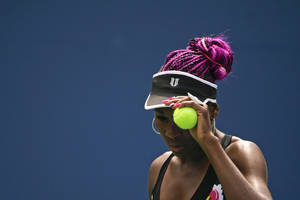 Photo - Venus Williams prepares to serve to Belgium's Kirsten Flipkens during the first round of the 2013 U.S. Open tennis tournament Monday, Aug. 26, 2013, in New York. (AP Photo/David Goldman)