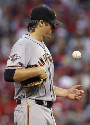 Photo - San Francisco Giants starting pitcher Michael Kickham waits on the mound to be taken out in the third inning of a baseball game against the Cincinnati Reds, Monday, July 1, 2013, in Cincinnati. Kickham pitched two and two-thirds innings, giving up seven runs on nine hits. (AP Photo/Al Behrman)