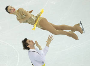 Photo - Stefania Berton and Ondrej Hotarek of Italy compete in the team pairs short program figure skating competition at the Iceberg Skating Palace during the 2014 Winter Olympics, Thursday, Feb. 6, 2014, in Sochi, Russia. (AP Photo/Vadim Ghirda)