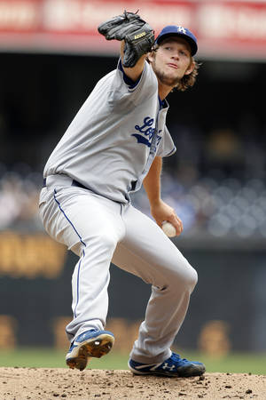 Photo -   Los Angeles Dodgers' Clayton Kershaw delivers a pitch in the first inning of a baseball game against the San Diego Padres, Sunday, Sept. 25, 2011, in San Diego. (AP Photo/Chris Park)