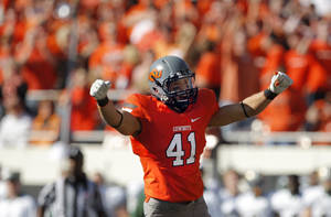 Photo - Oklahoma State's Nico Ornelas (41) celebrates a fumble recovery on a kick off during a college football game between the Oklahoma State University Cowboys (OSU) and the Baylor University Bears (BU) at Boone Pickens Stadium in Stillwater, Okla., Saturday, Oct. 29, 2011. Photo by Sarah Phipps, The Oklahoman