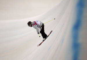 Photo - Bronze medalist Japan's Ayana Onozuka skis in her final run in the women's ski halfpipe competition at the Rosa Khutor Extreme Part, at the 2014 Winter Olympics, Thursday, Feb. 20, 2014, in Krasnaya Polyana, Russia. (AP Photo/Charlie Riedel)