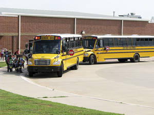 Photo - Deer Creek Elementary School students prepare to board buses Monday. The district is considering a teaching plan that could delay the start of school one day each week. Photo by Vallery Brown, THE OKLAHOMAN