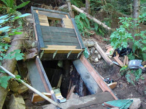 Photo -   This undated photo provided by the King County Sheriff's Department on Friday, April 27, 2012, shows a bunker that deputies say belongs to a man suspected of killing his wife and daughter and holing up for days in the Cascade foothills east of Seattle. King County Sheriff's Sgt. Cindi West says authorities pumped gas into the underground bunker and they believe someone is inside. (AP Photo/King County Sheriff's Department)