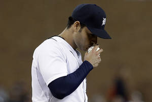 Photo - Detroit Tigers pitcher Anibal Sanchez kisses the ball after striking out Atlanta Braves' Juan Francisco in the eighth inning of a baseball game in Detroit, Friday, April 26, 2013. (AP Photo/Paul Sancya)