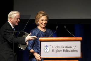 Photo - Former North Carolina Governor Jim Hunt thanks former first lady and U.S. Secretary of State Hillary Clinton after speaking at a conference on the globalization of higher education at Four Seasons Resort and Club Las Colinas in Irving, Texas, Monday, March 24, 2014. (AP Photo/The Dallas Morning News, Lara Solt)