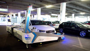 "Photo - Parking robot ""Ray"" transports a car in Duesseldorf, Germany, Monday, 23 June 2014. The parking robot will see service for the first time at Duesseldorf Airport. (AP Photo/dpa, Federico Gambarini)"