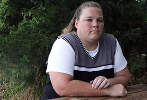 Photo -   This undated photo shows Amy Miller of Eudora, Kan. The Kansas Supreme Court has upheld a state law imposing a $250,000 cap on damages that can be awarded for pain and suffering in personal injury lawsuits. The court ruled Friday, Oct. 5, 2012, against Miller, who challenged the 1988 law imposing the cap on non-economic damages. Miller sued her doctor for removing the wrong ovary from her during surgery in 2002. A jury awarded her nearly $760,000 in damages in 2006, but the award was reduced. (AP Photo/Lawrence Journal-World, Phi Cauthorn)