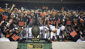 Photo - Oregon State players poses for photos after the Hawaii Bowl NCAA college football game against Boise State, Tuesday, Dec. 24, 2013, in Honolulu. (AP Photo/The Oregonian, Randy L. Rasmussen)