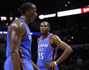 Photo - Oklahoma City's Kevin Durant (35) looks at Oklahoma City's Kendrick Perkins (5) as he reacts to a technical foul during Game 1 of the Western Conference Finals in the NBA playoffs between the Oklahoma City Thunder and the San Antonio Spurs at the AT&T Center in San Antonio, Monday, May 19, 2014. Photo by Sarah Phipps, The Oklahoman