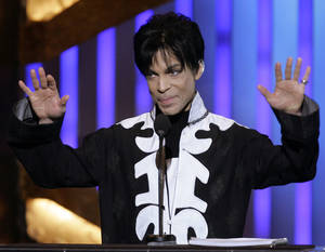 "Photo - FILE - In this March 2, 2007 file photo, Prince accepts an award during the NAACP Image Awards in Los Angeles. He is scheduled to appear on ""Late Night with Jimmy Fallon."" A rep for the late-night talk show confirmed the pop legend will appear on the show Friday, March 1, 2013, and perform two songs. (AP Photo/Chris Carlson, file)"