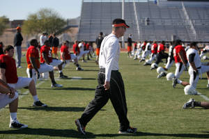 Photo - OKLAHOMA STATE UNIVERSITY / OSU / COLLEGE FOOTBALL: Oklahoma State head football coach Mike Gundy watches players stretch during the Oklahoma State Cowboys practice for the Fiesta Bowl at Scottsdale Community College in Scottsdale, Ariz.,  Tuesday, Dec. 27, 2011. Photo by Sarah Phipps, The Oklahoman