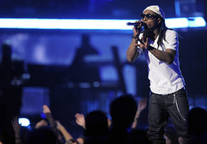 Photo - Lil Wayne performs at the 51st Annual Grammy Awards on Sunday, Feb. 8, 2009, in Los Angeles. (AP Photo/Mark J. Terrill)